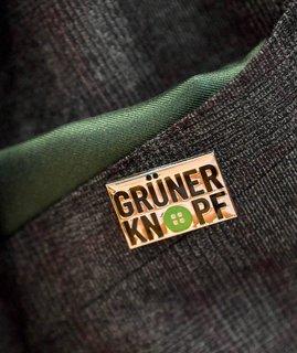 Subtile Botschaft: Minister Müllers grünes Einstecktuch.