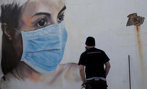 Mundschutz-Graffiti in Belgien.