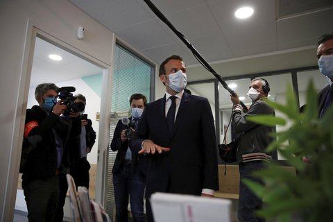 Safety comes first: French President Emmanuel Macron visits a clinic near Paris.